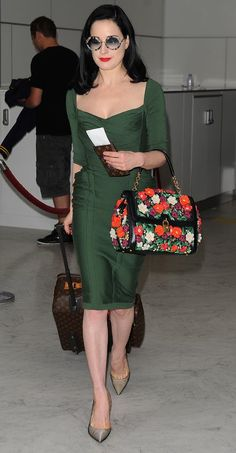 Dita Von Teese (2013) green dress                                                                                                                                                                                 More