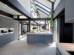 Huf Haus Kitchen and Entry. Love the beams.