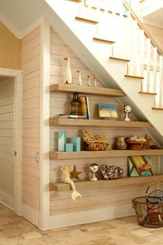 I've always loved the idea of shelves under a staircase.  A great use of space.