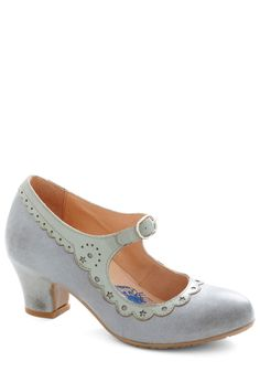 "Darling blue Mary Jane with ""distressing"" that would help extend the wear of these delicate pastel shoes.  It looks like something from a stage production of Alice In Wonderland or perhaps Peter Pan (I could see these for Wendy!)  Seriously darling."