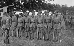BRITISH RESPONSE TO THE OUTBREAK OF WAR AUGUST 1914: CAMBRIDGE UNIVERSITY OFFICER TRAINING CORPS AT MYTCHETT CAMP. Cambridge University Officer Training Corps on parade.