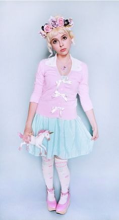 Pink Cardigan with White Ribbon Buttons, Mint Polkadot Retro BabyDoll Dress, Whip Showcase White Over Knee Socks, a Giant Floral Crown, and Bubblegum Pink Horse Shoes - http://ninjacosmico.com/16-fashion-tips-how-to-dress-fairy-kei/