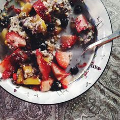 BREAKFAST - 1/2 cup rolled oats, pineapple, blueberries, strawberries, 1/2 cup silk vanilla almond milk, 2 tbsp cranberry almond #Qiacereal from Nature's Path and some goji berries.