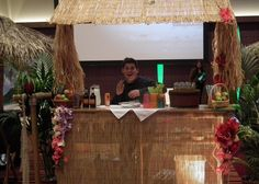 Why not have a cocktail maker serve cocktails at your very own Tiki Bar?
