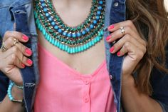I love this necklace especially with the pink shirt!