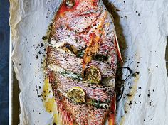 Whole Roast Fish with Lemon and Herbs   This whole fish stuffed with herbs, lemon and aromatics is easy to prepare and makes a gorgeous, hands-off main dish.