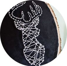 This beautiful string art is of a silhouette of a deer head with giant antlers. It's an elegant and beautiful string art craft.