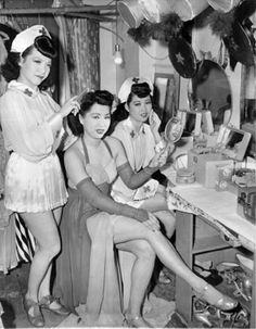 Performers Mary Ong, Fei Ying and Mae Dong in a dressing room at Forbidden City nightclub. April 13, 1942.