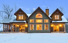 Steep pitched roof gables with decorative timber frame style trims. Screen porch to the left adds three season space. Antler Trail front view http://www.linwoodhomes.com/house-plans/plans/antler-trail/