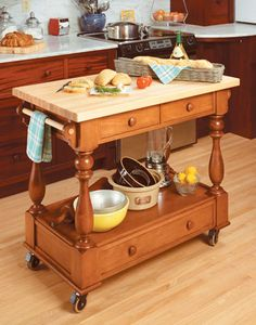 Kitchen Workstation   Woodsmith Plans -  With a large worksurface and lots of handy storage, this roll-around cart is sure to be a hit.  This rolling cart has it all. The large top, made from glued-up, edge-grain maple, provides a durable and attractive worksurface. With three drawers and a large space under the top, the cart is also a great place to store a few often-used kitchen items.