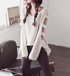 Cute cut out sleeved ivory sweater. This would look cute oversized to where it could be a short dress, then it would look cute with a pair of tights or knee high tights.