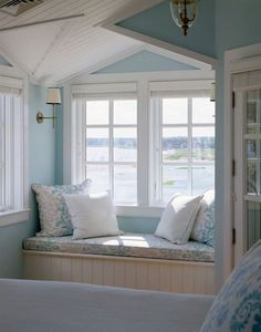Are you longing for a beach getaway? This window seat is the perfect spot to spend a dreamy afternoon. I have always wanted a home with a window seat with a great view! Beach House Tour, Beach House Decor, Summer House Decor, Pale Blue Paints, Deco Marine, Cozy Nook, Cosy Corner, Traditional Bedroom, Traditional Windows