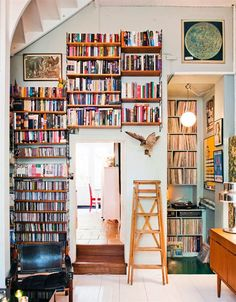 Books + vinyl nook = perfection. I would spend everyday in that room