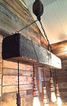 This is a Reclaimed Wood Beam Barn Pulley Light Fixture. The wood measure 6 x 6 and is 3 feet long and comes with 5 hanging pendants sockets built using steel pipe parts and finished with an aged copper color.   Includes one ceiling canopy kit for mounting to a ceiling box.  The pendant wire is a vintage cloth covered twisted style. The chandelier is wired using new UL listed electrical parts and in accordance with National Electrical Code by a licensed Master Electrician.  Bulbs not…