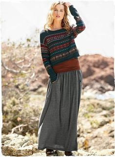 Our cropped pullover is banded in Fair Isle stripes of cranberry, deep teal, rust and indigo. Knit of lofty pima (70%) and alpaca (30%) bouc...