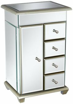 """Mirrored Glass Jewelry Box by Universal Lighting and Decor. $139.99. Flip top lid with mirror and hidden compartment.. 4 drawers.. 16 1/2"""" high.. 3 shelf compartment behind door.. Mirrored glass jewelry box.. This contemporary jewelry box is glamorous and stylish with mirrored glass. Chic and versatile, it packs an impressive amount of storage space within the compact design. It features four drawers on one side, and a door on the other that opens up to a three shelf compartment..."""
