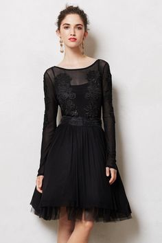 I am only mildly obsessed with this edgy-yet still romantic-dress!  #Anthropologie you have done it again!