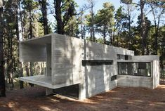 Two of the world's most powerful forces collide in this inspired concrete house: man versus nature. Yet, the two seem to sing in perfect harmony here. This bold but natural house design works wonderfully with its woody surroundings and the lake lapping at the shoreline just steps away, putting raw earth and modern architecture within arm's reach - now, this is our idea of an ideal cottage getaway! The massive sliding glass walls provide a barely-there boundary between the wild and our…