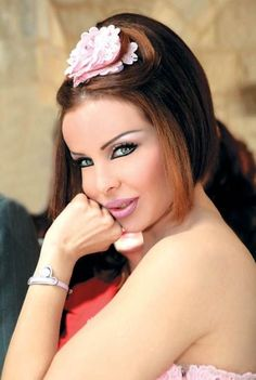 Rola Youssef Saad – A flashy Lebanese pop singer and model. Born August 25, 1978