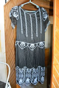 1920s beaded flapper dress, clear on black beading, great deco design on hem.