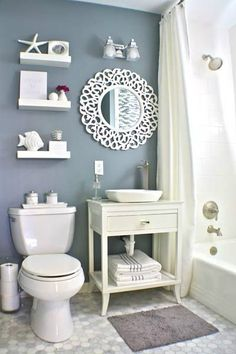 Use fluorescent lighting (softer and more even light).  nautical small bathroom design idea
