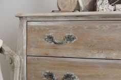 Distressed French Painted Dresser - paint a section of the furniture then wipe off the paint with a damp rag.  This is a great aged look that's so easy to do - via Burlap Luxe
