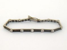 A French Art Deco onyx and diamond line bracelet, sold for £2,300.