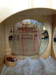 hanging burlap and a variety of ribbons and yarn invite children to weave at their leisure.