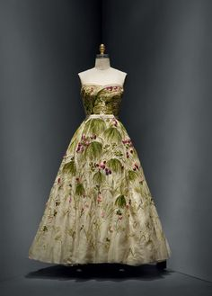 "Christian Dior (French, 1905–1957) for House of Dior (French, founded 1947). ""May"" Dress, spring/summer 1953, Haute Couture. Machine–sewn, hand–finished white silk organza and net, hand–embroidered with artificial flowers, clover, and grass in green, pink, and purple silk floss. Photo © Nicholas Alan Cope. #ManusxMachina #CostumeInstitute"