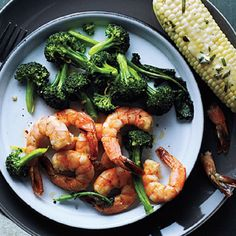 Roasted Shrimp and Broccoli by Cooking Light. Put dinner on the table fast by simply roasting shrimp and broccoli together for a quick, flavorful meal. Cooking Light Recipes, Clean Eating Recipes, Healthy Eating, Healthy Meals, Cooking Tips, Healthy Food, Shrimp And Broccoli, Broccoli Recipes, Steamed Broccoli