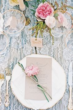 Lace and gold give an antique feel to this wedding table: http://www.stylemepretty.com/little-black-book-blog/2014/10/31/intimate-sunstone-villa-wedding/ | Photography: Khanh Hogland - http://www.khanhhogland.com/