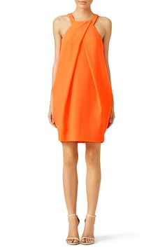 e21ac2b1e99 This bright orange Trina Turk dress has an structured feel. We love it for  engagement