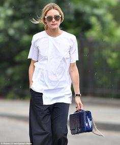 Throwing shade: The City alum hid her eyes behind a stylish pair of white, cat eye sunglasses