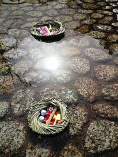 雛流し Hina-Nagashi. Nagashi-Bina: Divine service on March, 3rd of every year at Shimogamo-jinja, Kyoto, Japan that prays for child's good health. People release this doll into the Mitarashi-river with pray.