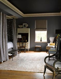 Painting your ceiling dark is a good way to disguise a low ceiling
