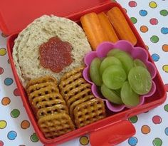 Homemade uncrustables bento...this lady used the Pampered Chef sandwich press to remove the crust for a homemade uncrustable.  We have new fruit cutters that would work well also for the little flower on top.   Easy way to make an inexpensive but cute lunch for your kids!