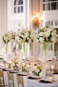 Tall wedding centerpieces not only look stunning, but are also functional- adding tons of dimension to your wedding decor and allowing guests to easily converse from a distance. Romantic Wedding Centerpieces, Romantic Wedding Receptions, Floral Centerpieces, Floral Arrangements, Mod Wedding, Wedding Table, Floral Wedding, Wedding Flowers, Wedding Ceremony