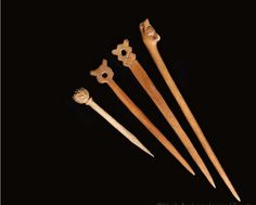 Over 130 bone pins were found at Coppergate. They varied in size and form, but all are likely to have acted as dress fastenings or possibly hair pins. The smallest of those illustrated has a decorated globular head, and must have been used on a garment of light material, perhaps a veil or some other type of head covering. The pin with the animal head may have come from Scandinavia. The pins with perforated heads were probably used in pairs.