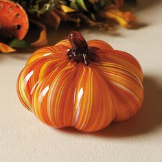 """This Great Pumpkin with its colorful molten swirls is a beautiful and instant way to annually say """"Autumn has arrived"""" Destined to star in fall tablescapes or on mantels or coffee tables Handblown glass Each Art Glass Pumpkin will vary"""