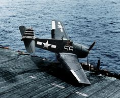 A USN Hellcat crash lands on a carrier deck...