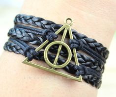 Deathly Hallows NecklaceHarry potter Bracelet by itouchsoul, $3.99