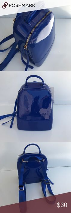 "Royal Blue Lattex Mini Backpack Fun pak. Trimmed in gold zipper and hardware. Measurements 9""H x 7""W x 4""D. Bags Backpacks"