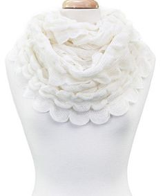 Sumptuously soft and stylish to boot, this chic scarf is a fashion-forward finishing touch. Boasting ravishing scalloped ruffles and a versatile infinity design, this sweet scarf is sure to become a fast favorite.