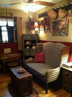 Country Prim...love the sofa, chest & chairs hanging on the wall rack...Bonnie A.