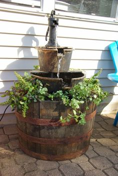 Our house, now a home: Projects. Turning a store bought small water fountain into a big and bulky showpiece perfect for outdoor living. A DIY project with full tutorial.