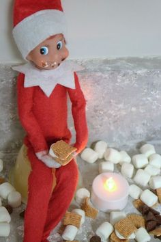 elf on the shelf scores from golden grahams cereal, chocolate chips, and mini marshmallows.