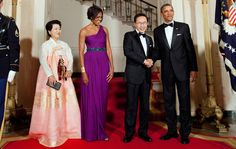 A long, tall, purple column one shouldered dress with a jewelry-like belt. Wow!