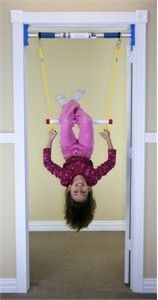 Indoor Trapeze Bar // This is cool, they also make a swing, ring, and ladder attachment...