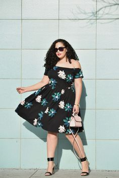 Girl With Curves blogger Tanesha Awasthi wears a Who What Wear off-shoulder floral midi dress