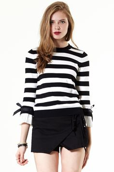 Ruffle N Bow Top Discover the latest fashion trends online at storets.com